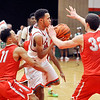 John P. Cleary |  The Herald Bulletin<br /> Anderson's Brandon Haralson drives through three Fishers defenders.
