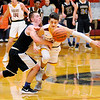 Don Knight | The Herald Bulletin<br /> Alexandria's Avery Paddock knocks the ball away from Burris' Jackson Adamowicz as the Tigers hosted the Owls on Thursday.