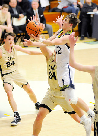 Don Knight   The Herald Bulletin<br /> Shenandoah's Andrew Bennett drives for a layup as the Raiders hosted the Lapel Bulldogs on Friday.