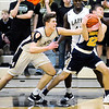 Don Knight | The Herald Bulletin<br /> Lapel's Luke Richardson gets tangled up with Shenandoah's Jordan Starks while reaching for the ball as the Bulldogs hosted the Raiders on Friday.