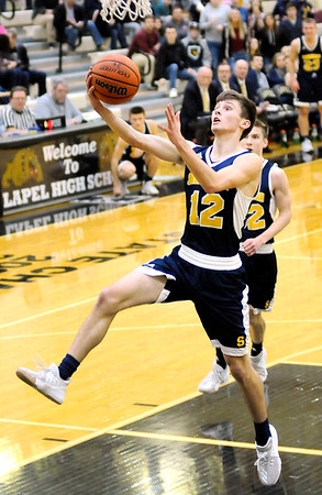 Don Knight | The Herald Bulletin<br /> Shenandoah's Jordan Starks drives for a layup as the Raiders traveled to Lapel on Friday.