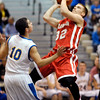 Frankton's Nick Wright puts up a shot as Matt Finnigan of Burris backs off Wrights drive to the basket.