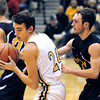 Lapel's Noah Hendershot fights off the defensive effort of Shandandoah's Kyle Demick during their first round game at the Lapel 2A sectional.