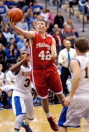 Frankton's Bailey Threet split the Burris defenders and drives to the basket for a layup.
