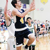 Chris Martin | For The Herald Bulletin<br /> Chase Kinsey drives in for a layup against Cloverdale. The Raiders lost 66-61 to Cloverdale in Regional 11 Saturday at Greenfield-Central