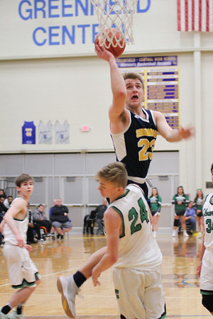 Chris Martin | For The Herald Bulletin<br /> Braydin Myers drives the lane for Shenandoah against Cloverdale. The Raiders lost 66-61 to Cloverdale in Regional 11 Saturday at Greenfield-Central