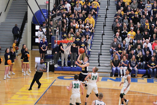 Chris Martin | For The Herald Bulletin<br /> Andrew Bennett drives for a layup late in the game against Cloverdale. The Raiders lost 66-61 to Cloverdale in Regional 11 Saturday at Greenfield-Central