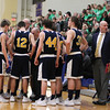 Chris Martin | For The Herald Bulletin<br /> Shenandoah head coach Dave McCollough draws up a late play with Shenandoah trailing by 3 in the final minute against Cloverdale. The Raiders lost 66-61 to Cloverdale in Regional 11 Saturday at Greenfield-Central
