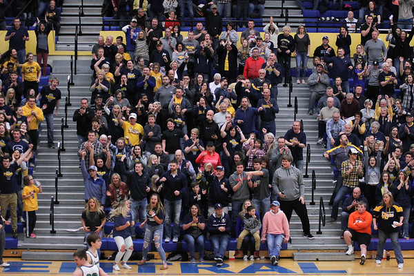 Chris Martin | For The Herald Bulletin<br /> Shenandoah fans cheer on their team at during the Regional matchup against Cloverdale. The Raiders lost 66-61 to Cloverdale in Regional 11 Saturday at Greenfield-Central