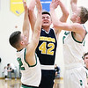 Chris Martin | For The Herald Bulletin<br /> Raider Forward Peyton Starks drives to the rim against Cloverdale. The Raiders lost 66-61 to Cloverdale in Regional 11 Saturday at Greenfield-Central