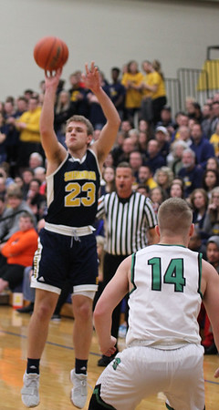 Chris Martin | For The Herald Bulletin<br /> Shenandoah's Braydin Myers takes a jump shot against Cloverdale<br /> The Raiders lost 66-61 to Cloverdale in Regional 11 Saturday at Greenfield-Central