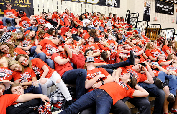 Don Knight | The Herald Bulletin<br /> Frankton's student section pretends to be asleep as Southwood's starting five are introduced during the semi-final round of the regional at Lapel on Saturday.