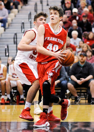 Don Knight | The Herald Bulletin<br /> Frankton's Rylan Detling drives the baseline for a basket as the Eagles faced the Southwood Knights in the semi-final round of the regional at Lapel on Saturday.