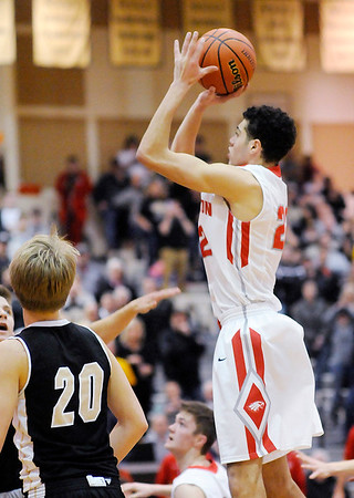 Don Knight | The Herald Bulletin<br /> Frankton's Maurice Knight hits the winning basket in the final seconds of the regional championship at Lapel on Saturday.