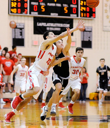 Don Knight | The Herald Bulletin<br /> Frankton's Maurice Knight breaks up a pass to Covington's Ty Bever during  the regional championship at Lapel on Saturday.