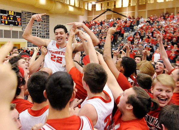 Don Knight | The Herald Bulletin<br /> Frankton hoists Maurice Knight in the air after winning the regional on a game winning shot by Knight at Lapel on Saturday.