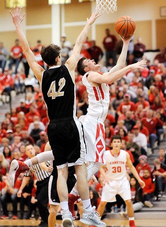 Don Knight | The Herald Bulletin<br /> Frankton's Keegan Freestone draws a foul on a drive to the basket for a three-point play as the Eagles faced Covington in the regional championship at Lapel on Saturday.