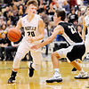 Don Knight | The Herald Bulletin<br /> Madison-Grant's Wyatt Rudy drives a he is guarded by Covington's Ollie Pettit in the semi-final of the regional at Lapel on Saturday.