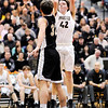Don Knight | The Herald Bulletin<br /> Madison-Grant's Brockton Butcher shoots as he is guarded by Covington's Tanner Cates in the semi-final of the regional at Lapel on Saturday.