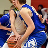 Richard Sitler | For The Herald Bulletin<br /> Eastern Hancock's Peyton Gray and Shenandoah defender Jackson Campbell battle in the first half during the 2A basketball sectional 42 semi-finals at Knightstown on Friday.