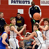 Richard Sitler | For The Herald Bulletin<br /> Shenandoah and Eastern Hancock players keep their eyes on a loose ball in the fourth quarter during the 2A basketball sectional 42 semi-finals at Knightstown on Friday.