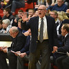 Richard Sitler | For The Herald Bulletin<br /> Shenandoah coach Dave McCollough shouts instructions to his players during the 2A basketball sectional 42 semi-finals at Knightstown on Friday.