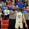 Richard Sitler | For The Herald Bulletin<br /> During the pregame starting lineups Shenandoah's Andrew Bennett fist bumps one of the officials during the 2A basketball sectional 42 semi-finals at Knightstown on Friday.