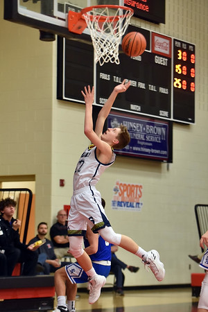 Richard Sitler | For The Herald Bulletin<br /> Kaden McCollough attempts a layup for the Raiders off a fast break in the second quarter during the 2A basketball sectional 42 semi-finals at Knightstown on Friday.