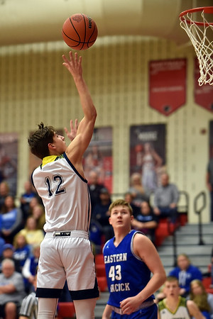 Richard Sitler   For The Herald Bulletin<br /> Shenandoah's Andrew Bennett puts up a floater in the lane during the first quarter as Eastern Hancock's Peyton Gray looks on during the 2A basketball sectional 42 semi-finals at Knightstown on Friday.