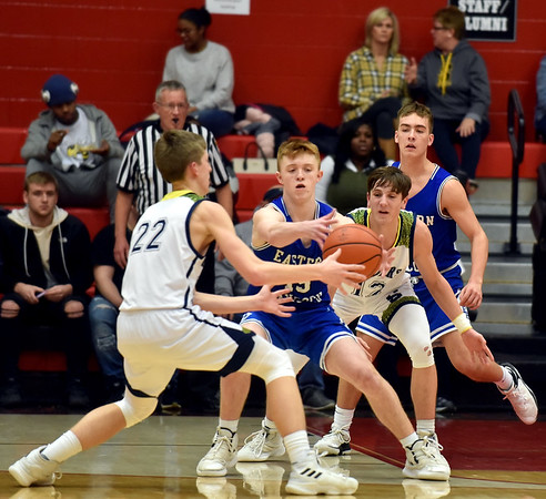 Richard Sitler   For The Herald Bulletin<br /> Eastern Hancock's Cole Rainbolt tries to grab the ball away from the double team defense of Shenandoah's Kaden McCollough (22) and Andrew Bennett (12) in the third quarter during the 2A basketball sectional 42 semi-finals at Knightstown on Friday.