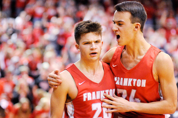 Don Knight   The Herald Bulletin<br /> Ayden Brobston, right, celebrates Jon Hatzell's clutch three-pointer to tie the score and send the game into a second overtime at Lafayette Jeff on Saturday.