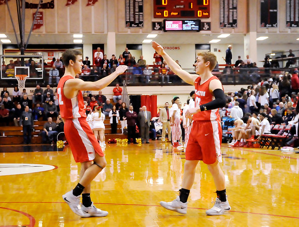 Don Knight   The Herald Bulletin<br /> Colt Litsey salutes Brayton Cain as he is introduced during the semi-state at Lafayette Jeff on Saturday.