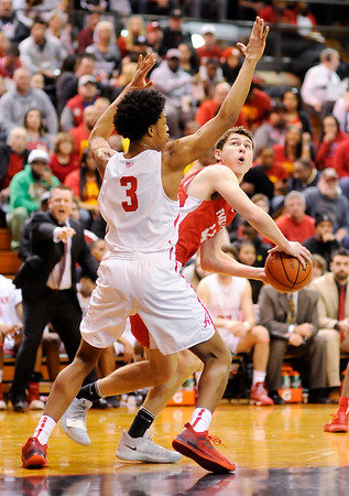 Don Knight   The Herald Bulletin<br /> Frankton's Will Whatley looks to shoot as he is guarded by Andrean's Eric Kendrick in the semi-state at Lafayette Jeff on Saturday.