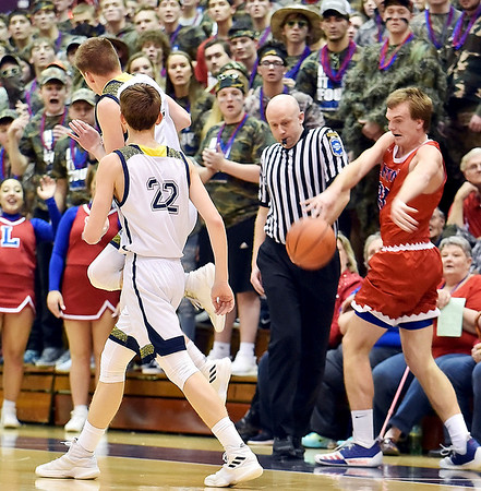 Richard Sitler | for The Herald Bulletin<br /> With Shenandoah players Evan Coers (32) and Kaden McCollough (22) as well as the official and Linton-Stockton fans looking on, Linton-Stockton senior Silans Robbins tries to save a ball from going out of bounds during the second half. Shenandoah fell to Linton-Stockton 73-56 in the Seymour Semi-State on Saturday.