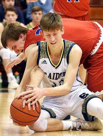 Richard Sitler   for The Herald Bulletin<br /> Shenandoah's Kaden McCollough and Linton's Samuel Robbins battle for control of the ball during the second half. Shenandoah fell to Linton-Stockton 73-56 in the Seymour Semi-State on Saturday.
