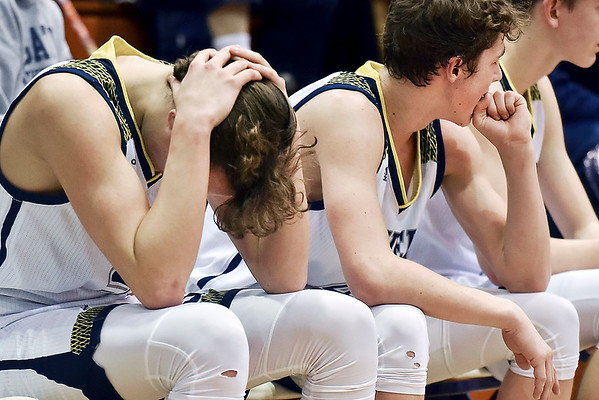 Richard Sitler   for The Herald Bulletin<br /> Shenandoah players on the bench react to the game slipping away as time runs out during the fourth quarter. Shenandoah fell to Linton-Stockton 73-56 in the Seymour Semi-State on Saturday.