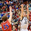 Richard Sitler | for The Herald Bulletin<br /> Shenandoah senior Evan Coers shoots a three-pointer over LInton's Lincoln Hale during the fourth quarter. Shenandoah fell to Linton-Stockton 73-56 in the Seymour Semi-State on Saturday.