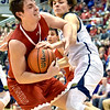 Richard Sitler | for The Herald Bulletin<br /> Linton junior Kip Fourgerousse and Shenandoah junior Jackson Campbell fight for control of the ball during the second half. Shenandoah fell to Linton-Stockton 73-56 in the Seymour Semi-State on Saturday.