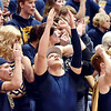 Richard Sitler | for The Herald Bulletin<br /> A member of the Shenandoah student cheering section appears to be calling to a higher power to assist the Raiders during the second half. Shenandoah fell to Linton-Stockton 73-56 in the Seymour Semi-State on Saturday.