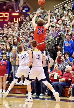 Richard Sitler   for The Herald Bulletin<br /> With Shenandoah players Evan Coers (32) and Kaden McCollough (22) as well as the Linton-Stockton fans looking on, Linton-Stockton senior Silans Robbins tries to save a ball from going out of bounds during the second half. Shenandoah fell to Linton-Stockton 73-56 in the Seymour Semi-State on Saturday.