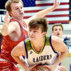 Richard Sitler | for The Herald Bulletin<br /> Shenandoah's Peyton Starks looks to drive past Linton defender Samuel Robbins during the second half. Shenandoah fell to Linton-Stockton 73-56 in the Seymour Semi-State on Saturday.