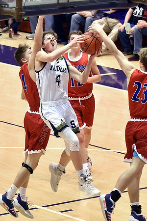 Richard Sitler | for The Herald Bulletin<br /> Shenandoah sophomore Jakeb Kinsey takes the ball to the basket against three Linton defenders during the second half. Shenandoah fell to Linton-Stockton 73-56 in the Seymour Semi-State on Saturday.