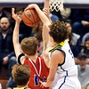 Richard Sitler | for The Herald Bulletin<br /> Shenandoah junior Jackson Cambell blocks the shot of LInton's LIncoln Hale during the first half of the 2A boys semi-state between Linton-Stockton and Shenandoah at Seymour on Saturday.