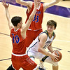 Richard Sitler | for The Herald Bulletin<br /> Shenandoah junior Peyton Starks finds himself trapped by the LInton double team of Evan Slover (10) and Samuel Robbins (33) after Starks grabbed a rebound during the fourth quarter. Shenandoah fell to Linton-Stockton 73-56 in the Seymour Semi-State on Saturday.