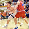 Richard Sitler | for The Herald Bulletin<br /> Shenandoah's Peyton Starks drives past Linton defender Samuel Robbins during the first half of the 2A boys semi-state between Linton-Stockton and Shenandoah at Seymour on Saturday.