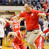 Don Knight | The Herald Bulletin<br /> Frankton head coach Brent Brobston runs onto the floor as the Eagles celebrate their semi-state win over Marquette Catholic at Lafayette Jeff on Saturday.