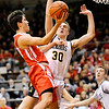Don Knight | The Herald Bulletin<br /> Frankton's Kayden key drives for a layup against Marquette Catholic's Joe Andershock during the semi-state at Lafayette Jeff on Saturday.