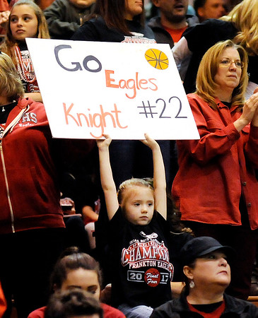 Don Knight | The Herald Bulletin<br /> A young Frankton fan holds up a sign with the number of senior Maurice Knight as the Eagles beat Marquette Catholic to win the semi-state at Lafayette Jeff on Saturday.