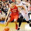 Don Knight | The Herald Bulletin<br /> Frankton's Maurice Knight drives into the lane past Marquette Catholic's Jonathan Andershock during the semi-state at Lafayette Jeff on Saturday.