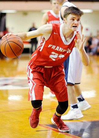 Don Knight   The Herald Bulletin<br /> Frankton's Keegan Freestone drives to the basket as the Eagles faced Marquette Catholic in the semi-state at Lafayette Jeff on Saturday.